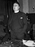 0068275 © Granger - Historical Picture ArchiveCHARLES EDWARD COUGHLIN   (1891-1979). American (Canadian-born) Roman Catholic priest. Coughlin testifying at the National Monetary Conference in Washington, D.C., January 1935.