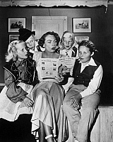 0170624 © Granger - Historical Picture ArchiveJOAN CRAWFORD (1908-1973).   American actress. Crawford directing some young thespians (her daughter, Christina, at left) in the play, Hansel and Gretel, c1950.