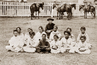 0016150 © Granger - Historical Picture ArchiveFATHER DAMIEN (1840-1889).   Belgian Roman Catholic missionary. Father Damien with his choir of leper girls at the Molokai Leprosarium, Hawaii, c1880.