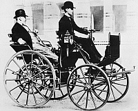 0033464 © Granger - Historical Picture ArchiveGOTTLIEB DAIMLER   (1834-1900). German engineer and pioneer automobile manufacturer. Gottlieb Daimler, at left, enjoying a ride in the first automobile he manufactured and which is here driven by his son Adolf, in 1886.