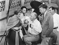 0048449 © Granger - Historical Picture ArchiveCECIL B. DeMILLE (1881-1959).   American film director and producer. With Elissa Lamdi and cameraman Karl Struss on the set of