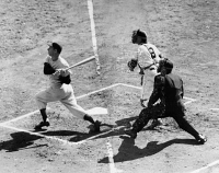 0170340 © Granger - Historical Picture ArchiveJOE DIMAGGIO (1914-1999).   American baseball player. As a member of the New York Yankees, fouling off a pitch while batting against the New York Giants in Game 4 of the 1951 World Series at the Polo Grounds in New York City, 8 October 1951. Watching at right are Giants catcher Wes Westrum and home plate umpire Al Barlick.