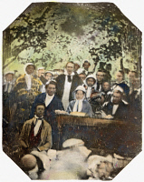 0064544 © Granger - Historical Picture ArchiveFREDERICK DOUGLASS   (c1817-1895). American abolitionist. Douglass (seated at table beside a Quaker woman wearing a bonnet) and other abolitionists at the open-air Fugitive Slave Law Convention, Cazenovia, New York, 22 August 1850. Oil over a daguerreotype by Ezra Greenleaf Weld.