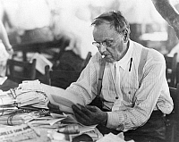 0005199 © Granger - Historical Picture ArchiveCLARENCE DARROW (1857-1938).   American lawyer; reading his mail during a lull in the Scopes Trial at Dayton, Tennessee, July 18, 1925.