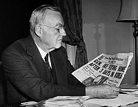 0170035 © Granger - Historical Picture ArchiveJOHN FOSTER DULLES   (1888-1959). American lawyer and diplomat. As President-elect Dwight D. Eisenhower's Secretary of State-designate, holding a copy of a newspaper reporting on Eisenhower's visit to Korea, December 1952.
