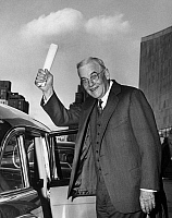 0170621 © Granger - Historical Picture ArchiveJOHN FOSTER DULLES   (1888-1959). American lawyer and diplomat. Dulles waving with his 'Atoms for Peace' speech after delivering it at the United Nations General Assembly, September 1954.