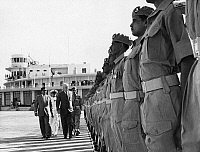0170623 © Granger - Historical Picture ArchiveJOHN FOSTER DULLES   (1888-1959). American lawyer and diplomat. Dulles, while Secretary of State, reviews the Pakistan Honor Guard after arriving in Karachi, c1956.