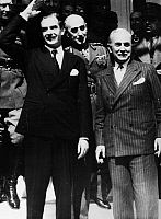 0170616 © Granger - Historical Picture ArchiveANTHONY EDEN (1897-1977).   British politician. Eden, while Secretary of State for Foreign Affairs, waving to a crowd in Athens, Greece, outside the Grande Bretagne Hotel, March 1941. At right is Greek Prime Minister Alexandros Koryzis and in center is General Alexander Papagos. At far left is British commander John Dill.