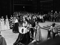 0621844 © Granger - Historical Picture ArchiveQUEEN ELIZABETH II (1926- ).   Queen of Great Britain. At her coronation, receiving the royal spurs from Lord Great Chamberlain George Cholmondeley. Photograph, 2 June 1953.