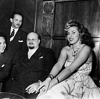 0169992 © Granger - Historical Picture ArchiveFAROUK I (1920-1965).   King of Egypt, 1936-1952. The exiled former king (with beard) photographed at the Hotel Ambasciatori in Rome, Italy, with Italian opera singer Irma Capece Minutolo (1935- ), December 1954.