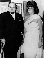 0169994 © Granger - Historical Picture ArchiveFAROUK I (1920-1965).   King of Egypt, 1936-1952. The exiled former king photographed with his longtime companion, the Italian opera singer Irma Capece Minutolo (1935- ), prior to her performance at a club in Naples, Italy, April 1963.