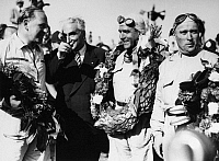 0170612 © Granger - Historical Picture ArchiveRACING DRIVERS, 1950.   Left to right: Reg Parnell, unidentified, Giuseppe Farina and Luigi Fagioli. Photographed after coming in first, second and third in the 1950 British Grand Prix at Silverstone Circuit in England.