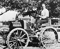 0622611 © Granger - Historical Picture ArchiveHENRY FORD (1863-1947).  American automobile manufacturer. Testing the 'Automobile Plow' tractor on his farm in Deaborn, Michigan. Photograph, 1907.