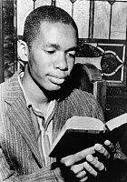 0621554 © Granger - Historical Picture ArchiveERNEST GREEN (1941-).   American man know for being a member of the Little Rock Nine, the group of African American students who first integrated Little Rock Central High School. Reading a Bible at a Church service in Little Rock, Arkansas. Photograph, 1957.