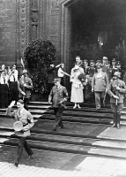 0623846 © Granger - Historical Picture ArchiveGÖRING MARRIAGE, 1935.   Hermann Göring and his second wife, Emmy Sonnemann, exiting the Berlin city hall after their civil marriage ceremony; Adolf Hitler walks before them. Photograph, 10 April 1935.