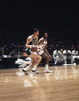 0170328 © Granger - Historical Picture ArchiveJOHN HAVLICEK (1940- ).   American basketball player. As a member of the Boston Celtics, dribbling past Walt Frazier of the New York Knicks during a game of the NBA Eastern Conference Finals at Madison Square Garden in New York City, April 1969.