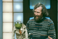 0633872 © Granger - Historical Picture ArchiveJIM HENSON (1936-1990).   American puppeteer, director, and screenwriter. With his Kermit the Frog puppet. Photograph, October 1983. Full Credit: ullstein bild - Teutopress / Granger. All Rights Reserved.