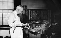 0108941 © Granger - Historical Picture ArchiveGEORGE EASTMAN (1854-1932).   American inventor and industrialist. Eastman working in his lab, 1920s.