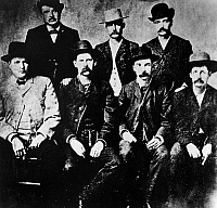 0131482 © Granger - Historical Picture ArchiveDODGE CITY COMMISSION.  The Dodge City Peace Commission. Seven gunfighters: seated left to righ: Charlie Bassett, Wyatt Earp, Frank McLain and Neal Brown. Standing, left to right: W.H. Harris, Luke Short and Bat Masterson. W.F. Petillon was retouched out of this 1890 copy of the original 1883 photograph.
