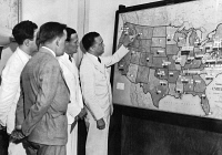 0067740 © Granger - Historical Picture ArchiveJOHN EDGAR HOOVER   (1895-1972). American lawyer and public official. Photographed in 1935 pointing to a map of the United States used to represent the course of federal crime investigations.