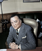 0165705 © Granger - Historical Picture ArchiveJOHN EDGAR HOOVER   (1895-1972). American lawyer and public official. Photographed in his office as Director of the F.B.I., 5 April 1940, digitally colored by Granger, NYC -- All Rights Reserved.