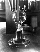 0004691 © Granger - Historical Picture ArchiveEDISON'S LIGHT BULB.   A replica of the first successful incandescent lamp, invented by Thomas A. Edison on 19 October 1879. The filament of carbonized cotton sewing thread burned for 40 hours.