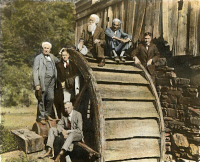 0056306 © Granger - Historical Picture ArchiveEDISON & FRIENDS, 1918.   Thomas A. Edison and friends on a camping trip at an old grist mill in West Virginia. Left to right are Edison, Harvey S. Firestone, Jr., John Burroughs, Henry Ford, Harvey S. Firestone. Seated is R.J.H. Loach. Oil over a photograph, 1918.