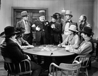0048289 © Granger - Historical Picture ArchiveW.C. FIELDS (1879-1946).   American comedian. W.C. Fields being escorted from a 'friendly' poker game. Still from 'My Little Chicadee,' 1940.