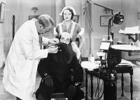 0070275 © Granger - Historical Picture ArchiveW.C. FIELDS (1879-1946).   American comedian. W.C. Fields in 'The Dentist,' 1932.
