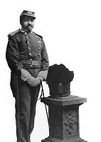 0062145 © Granger - Historical Picture ArchiveCHRISTIAN A. FLEETWOOD  (1840-1914). American soldier; recipient of Medal of Honor. Photographed in the 1870s, with ceremonial helmet placed on pedestal.