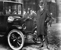 0005193 © Granger - Historical Picture ArchiveHENRY FORD (1863-1947).   American automobile manufacturer. Photographed with one of his Model T automobiles, c1920.