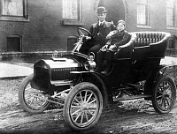 0016761 © Granger - Historical Picture ArchiveHENRY FORD (1863-1947)  Ford with his son Edsel in a 1905 Model F Ford in front of their home on Hendrie Avenue in Detroit. Photograph, 1905.