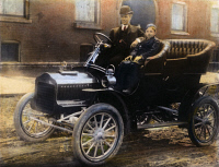 0039123 © Granger - Historical Picture ArchiveHENRY FORD (1863-1947)  and his son, Edsel, in a 1905 Model F Ford in front of their home on Hendrie Avenue, Detroit.