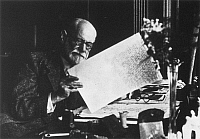 0001337 © Granger - Historical Picture ArchiveFREUD IN LONDON, 1938.   Austrian neurologist and founder of psychoanalysis. Reading his manuscript of 'An Outline of Psychoanalysis,' 1938.