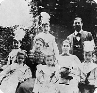 0084727 © Granger - Historical Picture ArchiveSIGMUND FREUD (1856-1939).   Austrian neurologist and founder of psychoanalysis. Freud's family in the garden at his home in Vienna, Austria, in 1898. From left: Front row: Sophie, Anna, and Ernst Freud. Middle row: Oliver and Martha Freud, Minna Bernays. Standing in back: Martin and Sigmund Freud.