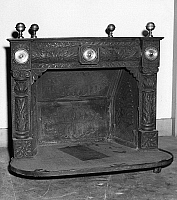 0175893 © Granger - Historical Picture ArchiveFRANKLIN: FIREPLACE.   Replica of the Pennsylvanian Fireplace, one of Benjamin Franklin's first inventions. Photograph, mid-20th century.