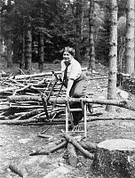 0063658 © Granger - Historical Picture ArchiveOLIVE FREMSTAD (1872-1951).  American (Swedish born) operatic soprano. Cutting wood at her Bridgton, Maine, home in 1913.