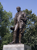 0082622 © Granger - Historical Picture ArchiveROBERT FULTON (1765-1815).   American engineer and inventor. Bronze statue, cast 1955, of Robert Fulton by Casper Buberl (1834-1899) in Fulton Park, Brooklyn. Fulton holds a model of his 'Nassau,' the first steam ferry between New York and Brooklyn.