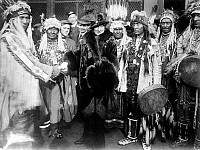 0115013 © Granger - Historical Picture ArchiveMARY GARDEN (1874-1967).   Scottish-American operatic soprano. Photographed with a group of Native Americans from Glacier National Park, Montana, early 20th century.