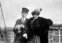 0115016 © Granger - Historical Picture ArchiveMARY GARDEN (1874-1967).   Scottish-American operatic soprano. Photographed with a man holding a bouquet of flowers while traveling on board a ship, early 20th century.