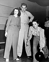 0027978 © Granger - Historical Picture ArchiveJUDY GARLAND (1922-1969).   American singer and actress. Bowling with Helen Parrish and Forrest Tucker, at the Hollywood Recreation Center, c1940.