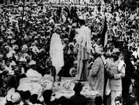 0354501 © Granger - Historical Picture ArchiveMOHANDAS GANDHI (1869-1948).   Indian nationalist and spiritual leader. Gandhi speaking at a rally in Peshawar, India, July 1938. Photograph.