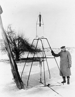 0013513 © Granger - Historical Picture ArchiveROBERT HUTCHINGS GODDARD   (1882-1945). American physicist. Photographed with the first liquid-propellant rocket to take flight, 16 March 1926, at Auburn, Massachusetts.