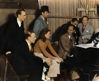 0050726 © Granger - Historical Picture ArchiveGEORGE GERSHWIN   (1898-1937). American composer. George Gershwin at the piano with, seated, Fred Astaire, and Ginger Rogers; standing, left to right, Hermes Pan, Mark Sandrich, Ira Gershwin and Nathaniel Shilkret on the film set of Shall We Dance. Oil over a photograph, 1936 or '37.