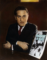 0052090 © Granger - Historical Picture ArchiveGEORGE GERSHWIN   (1898-1937). American composer. George Gershwin with the sheet music for his Rhapsody in Blue: oil over a photograph, 1924, the year it was first performed.