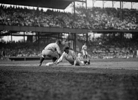 0527802 © Granger - Historical Picture ArchiveGEHRIG & GOSLIN, 1925.   Goose Goslin of the Washington Senators sliding to base against Lou Gehrig of the New York Yankees. Photograph, 1925.