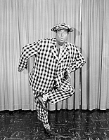 0054452 © Granger - Historical Picture ArchiveJACKIE GLEASON (1916-1987).   American comedian. In his famous 'And Away We Go' pose from The Jackie Gleason Show in the 1960's.