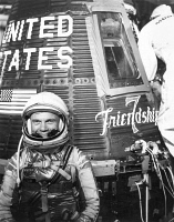 0004740 © Granger - Historical Picture ArchiveJOHN GLENN (1921-2016).  American astronaut and politician. Pictured with the Friendship 7 space capsule shortly before Glenn became the first American to orbit the Earth, 20 February 1962.