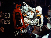 0184072 © Granger - Historical Picture ArchiveJOHN GLENN (1921-2016).   American astronaut and politician. Entering the Friendship 7 spacecraft prior to the launch of the Mercury-Atlas 6 mission. Photograph, 1962.
