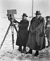 0122813 © Granger - Historical Picture ArchiveD.W. GRIFFITH (1875-1948).   American film producer and director. Griffith (right) and his cameraman G.W. 'Billy' Bitzer filming 'Way Down East' on location, 1920.
